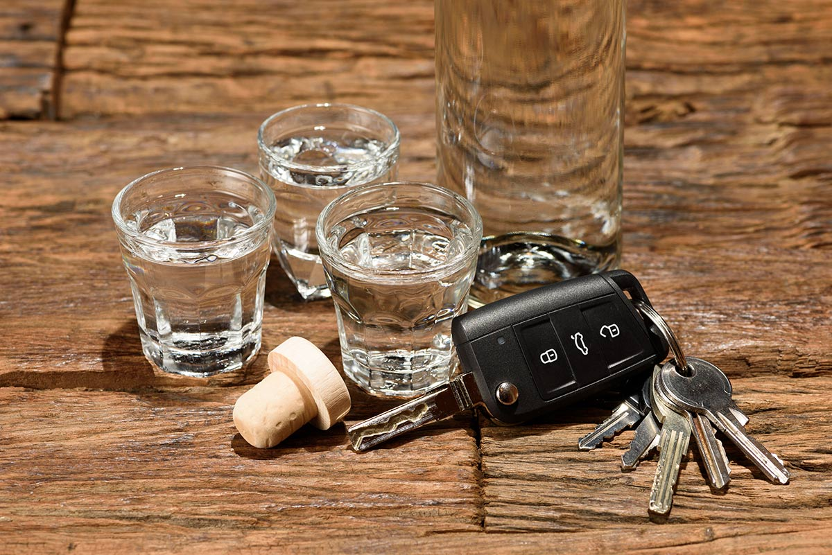 Photo of three shot glasses and a set of car keys