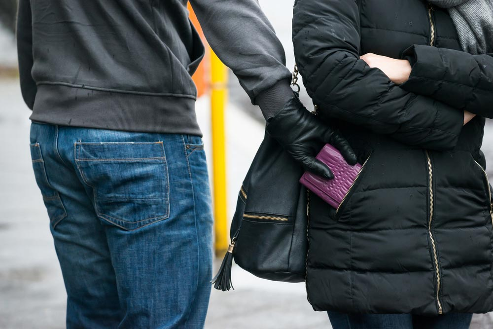 Photo of a man picking the pocket of a woman